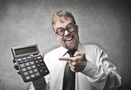 trickster: Smiling businessman showing a calculator