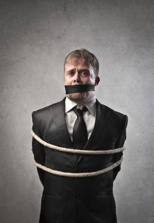 Sad businessman tied and muffled Stock Photo - 14171197