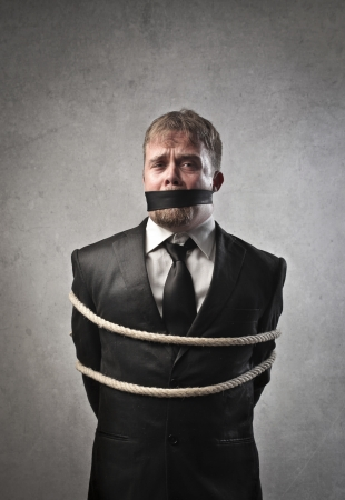 gagged: Sad businessman tied and muffled Stock Photo