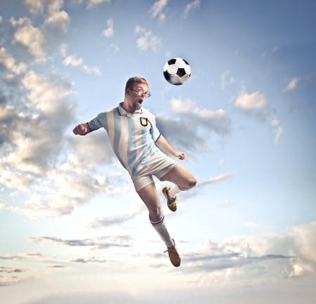 inefficient: Soccer player head-shooting a football Stock Photo