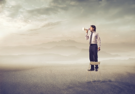 midst: man screaming isolated in the midst of nature with megaphone Stock Photo