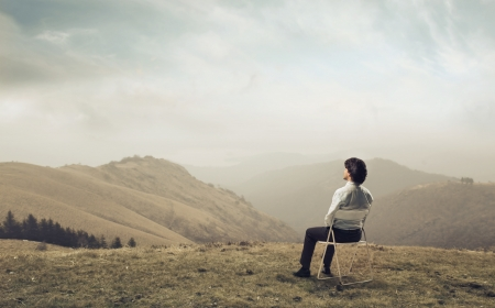 Businessman admiring a hills landscape photo