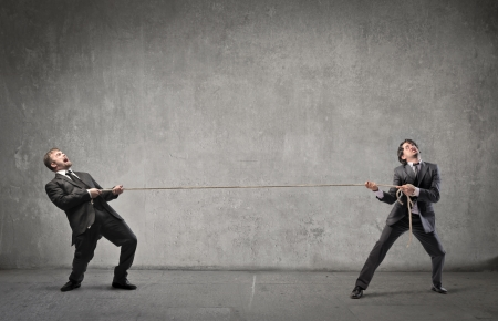 tug of war: Two businessmen compete for their success