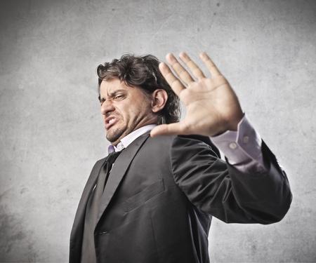 no gustar: Hombre de negocios expresar su disgusto pesada