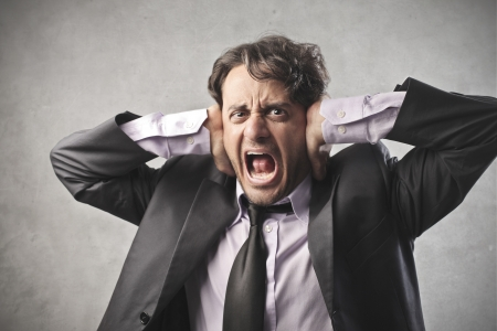 Businessman shouting for the stress photo