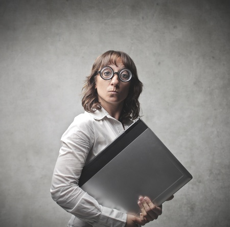ironic: A business woman with her laptop computer