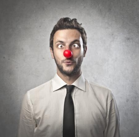 nez de clown: Homme d'affaires clown Banque d'images