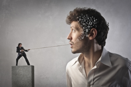 shyness: little man pulling rope from the mouth of a great man Stock Photo