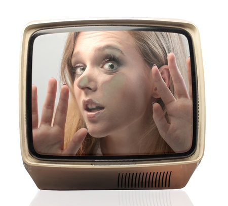 Beautiful girl trapped in the TV Stock Photo - 15112326