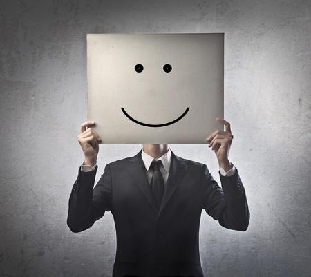 hipocres�a: Hombre de negocios con smiley en lugar de la cara del Foto de archivo