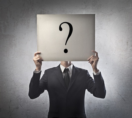 asking: Businessman with a question mark instead of the face Stock Photo