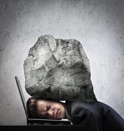 hard work: Businessman crushed by a boulder Stock Photo