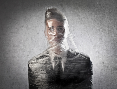 Businessman trapped in the plastic photo