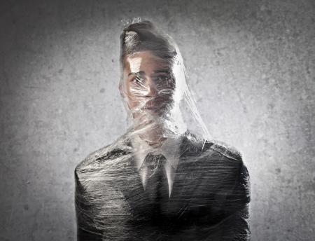 gefesselt: Geschäftsmann im Kunststoff eingeschlossen Lizenzfreie Bilder