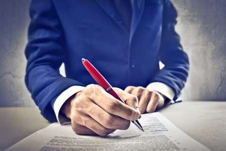 signing a contract: Businessman signing a contract