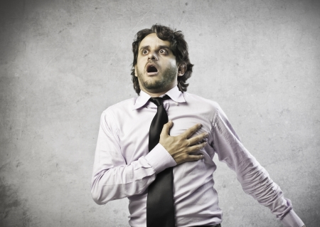 heart attack: Businessman is having a blow of heart