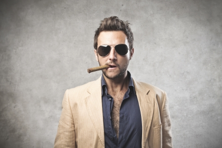 delinquent: Gangstar smoking a cigar Stock Photo
