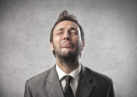 man crying: Businessman despairing