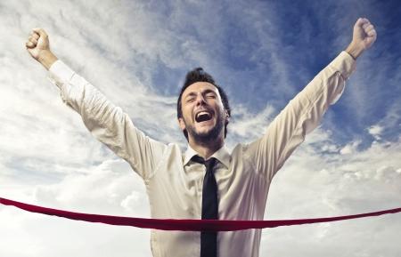 ganar: Empresario de cruzar la l�nea de meta Foto de archivo
