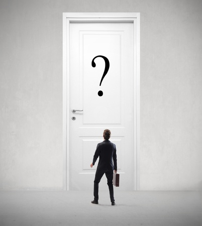 point of demand: Businessman in front of a door with a question mark