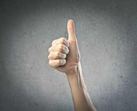thumb up: Slim thumb up Stock Photo