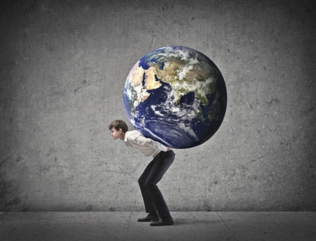 Young businessman holding the world on his shoulders Stock Photo - 15112609