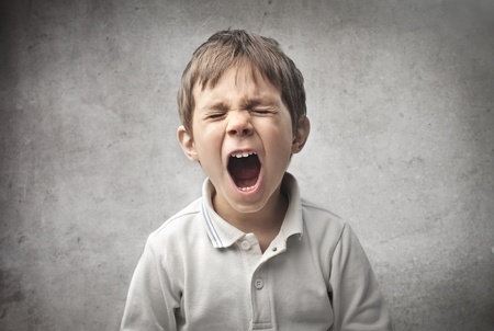 anger kid: Baby screaming Stock Photo