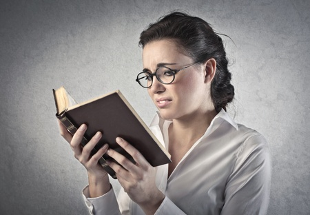 tedious: Woman involved in the reading of a book Stock Photo
