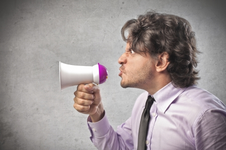 Businessman speaking in a mini-megaphone photo