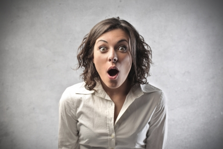 surprised: Mujer sorprendida abriendo la boca Foto de archivo