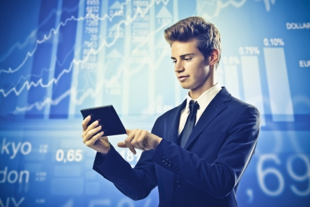 brokers: Young businessman using a tablet pc