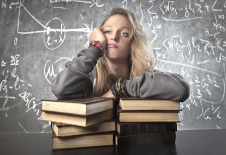 bored woman: Blonde girl bored by the study Stock Photo