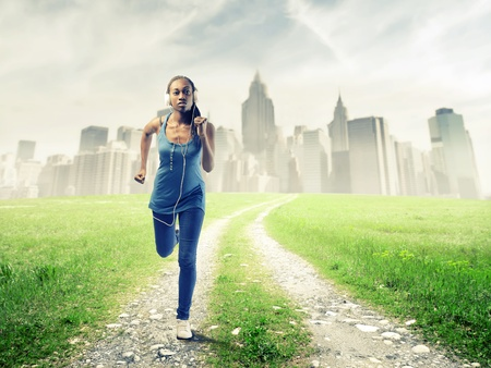 Black girl running in a grace field near New York Stock Photo - 15155584