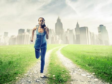 Black girl running in a grace field near New York Stock Photo - 15155584