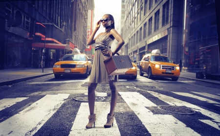 happy rich woman: Black girl posing on a New York street Stock Photo