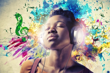 listen to music: Black Girl with Headphones Stock Photo