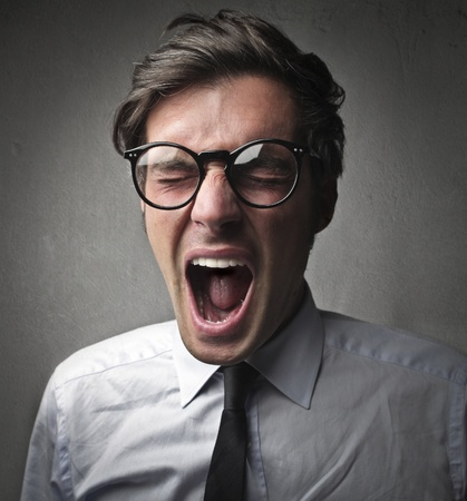 Fashionable man screaming photo