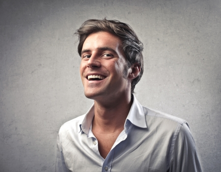 caucasian man: Man in white shirt smiling Stock Photo