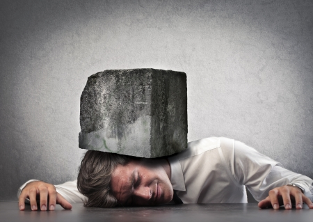 work load: Man crushed by a boulder Stock Photo