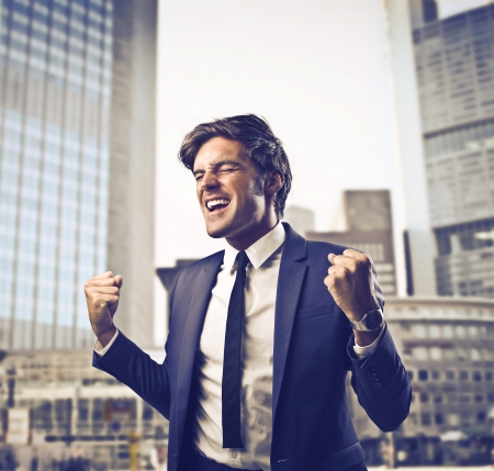 exult: Businessman rejoicing in his success