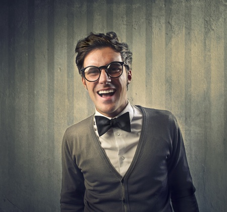 nerd glasses: Fashionable man with a black tie laughing Stock Photo