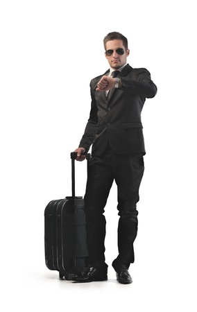 business briefcase: Businessman with his luggage checking the time on his watch Stock Photo