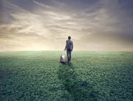 Businessman with his luggage in a wasteland Stock Photo - 15662514