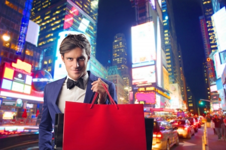 night market: Fashionable man holding a red shopping bag in New York
