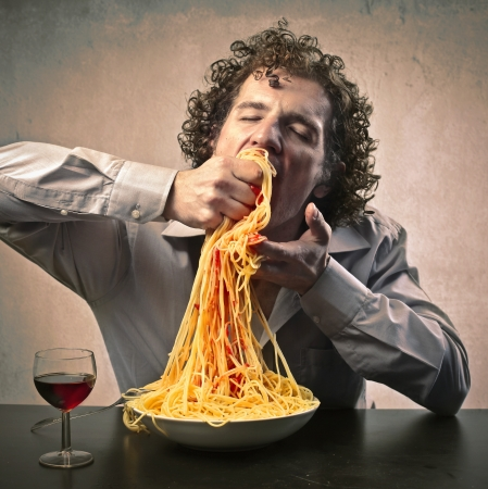 Man gorging of spaghetti photo