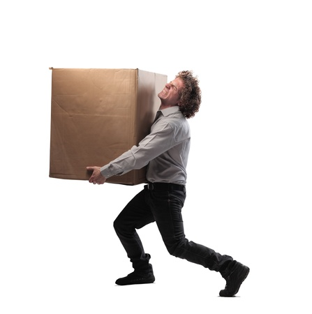 Businessman holding struggling a box Stock Photo - 15662589