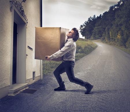 Businessman delivering a big box Stock Photo