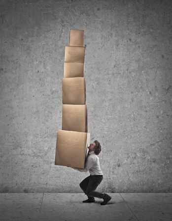 some: Businessman holding some boxes Stock Photo