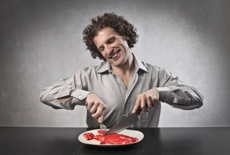 Happy man cutting a steak Stock Photo - 15662606