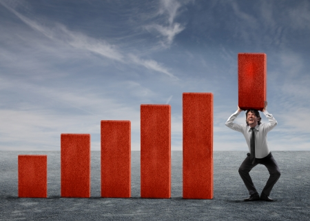 Businessman holding over his head a red analysis block Stock Photo - 15747526